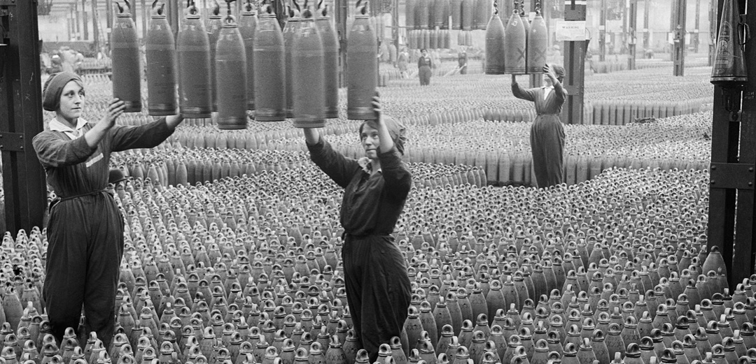 Female munitions workers arrange shells